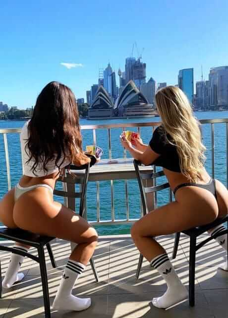 2 sexy girls on chairs sydney harbour